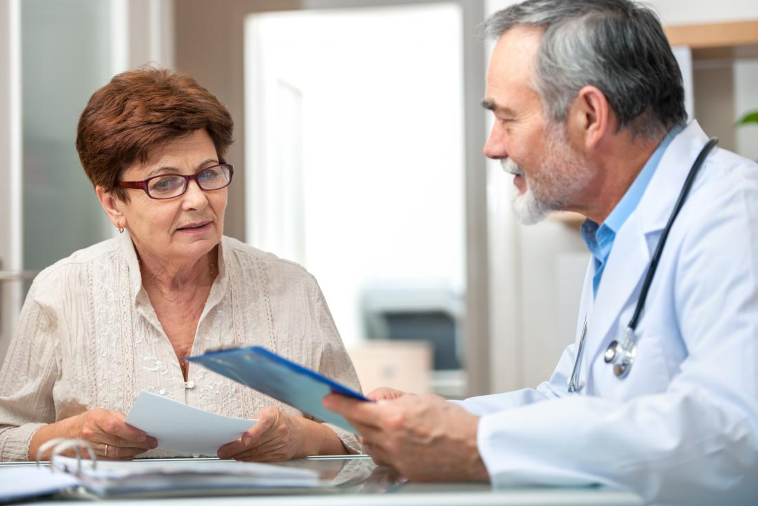 doctor explaining something to older lady