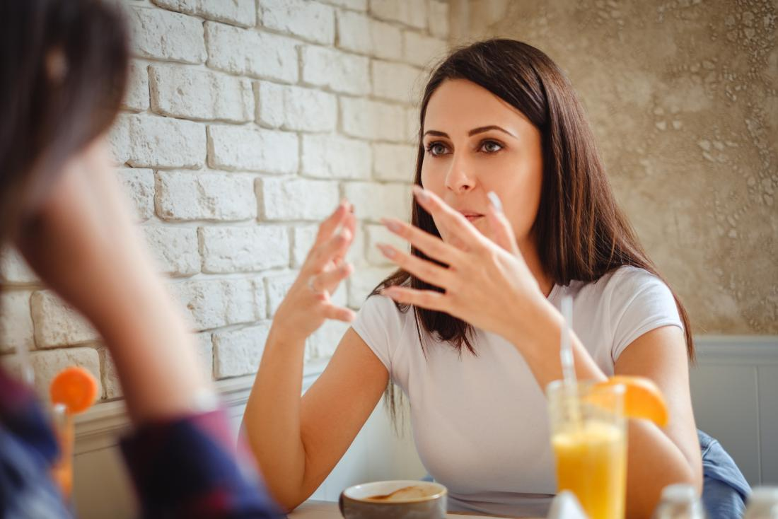 Woman talking to a friend over coffee who may have a speech disorder