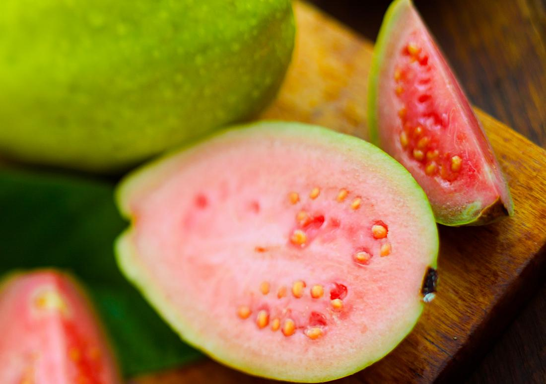 Guava fruit with health benefits cut up on chopping board