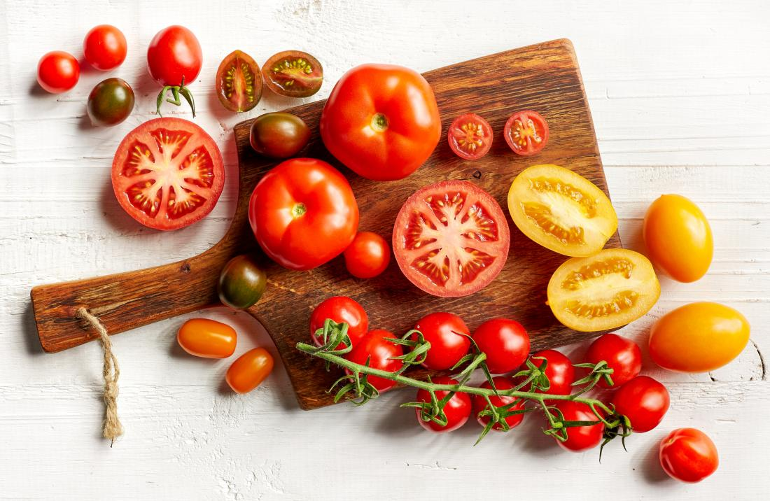 variety of tomatoes on a board