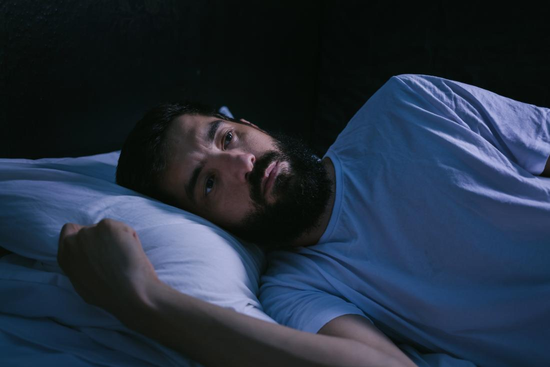 man suffering from insomnia