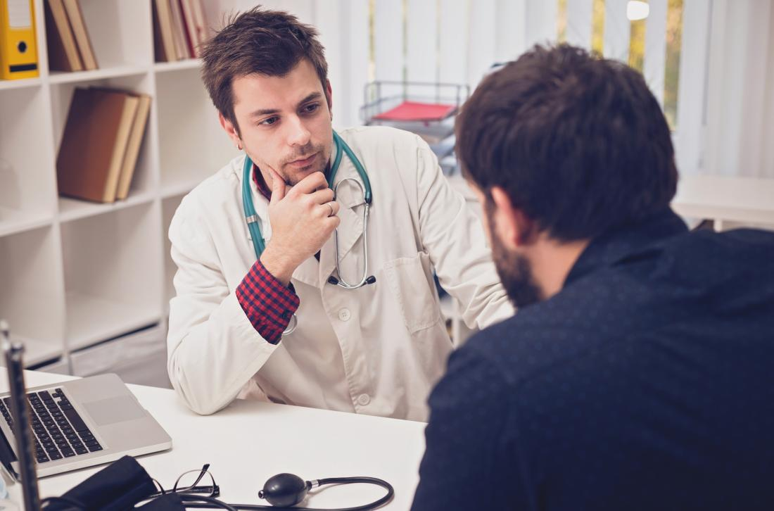 man speaking to male doctor