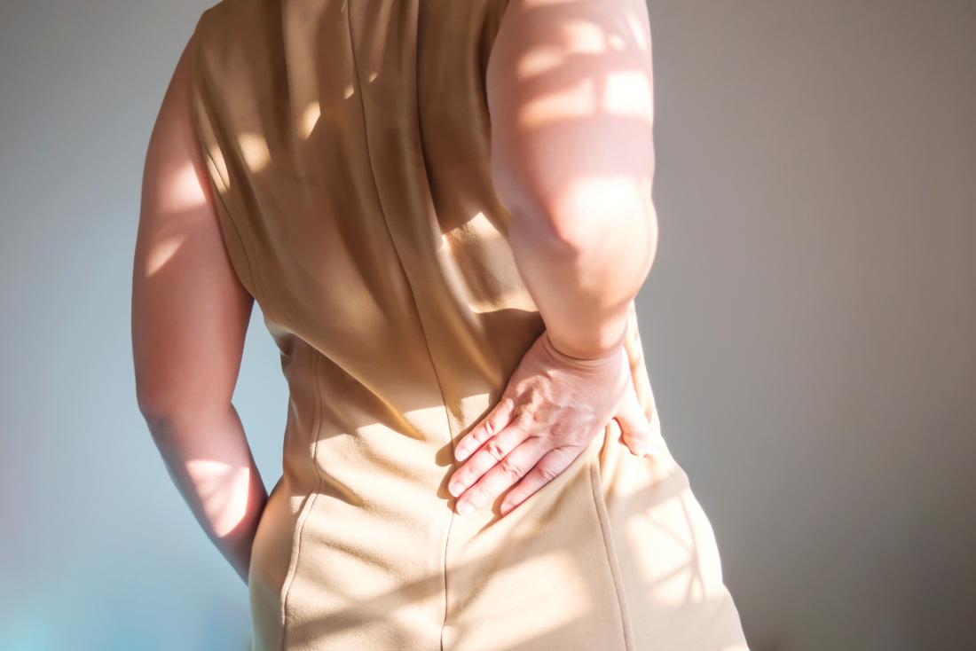 Person experiencing back and flank pain.