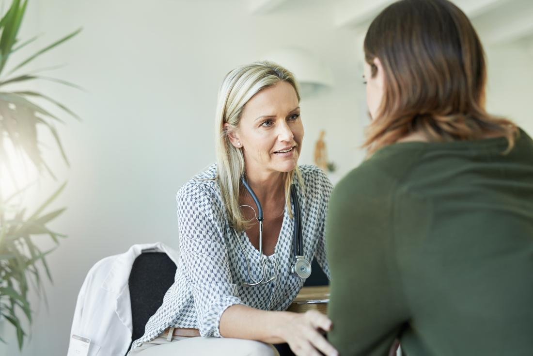 doctor reassuring female patient