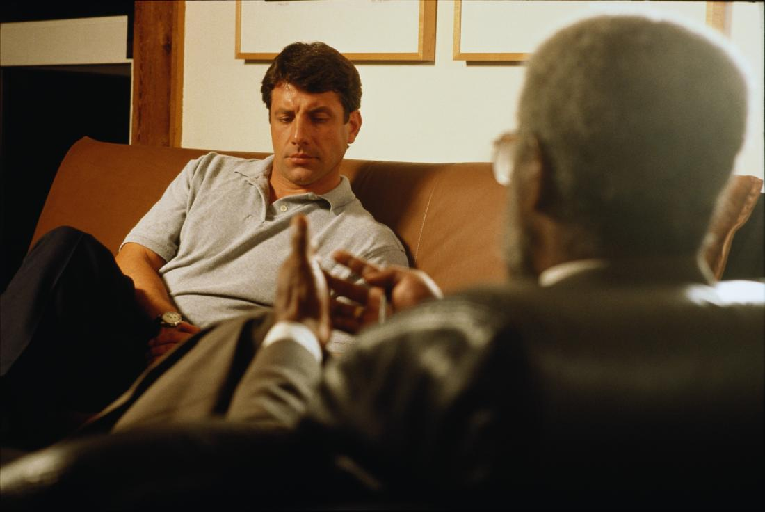 Man having therapy or counseling in psychiatrist office