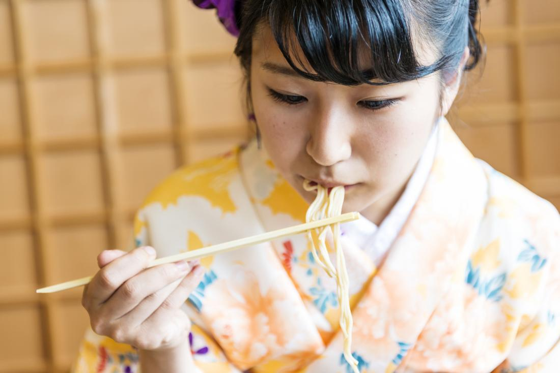 woman in kimono eating noodles