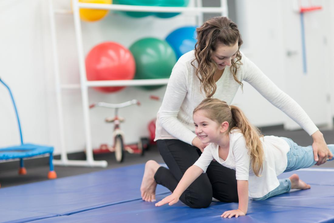 young girl having physical therapy