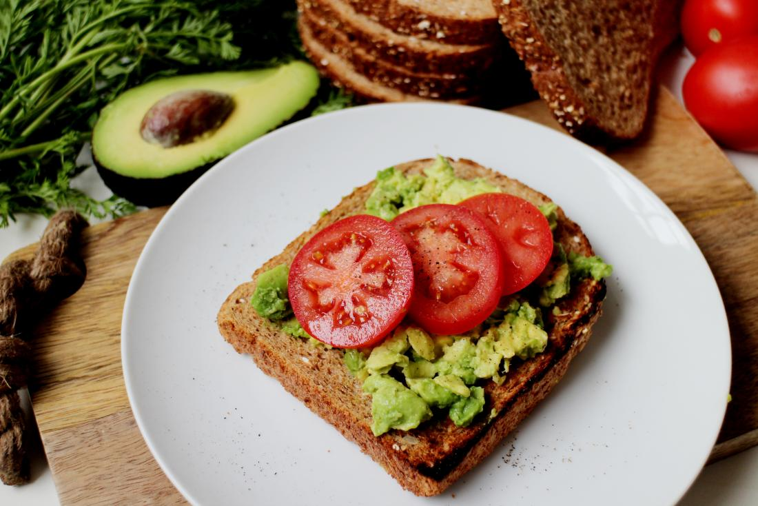 Avocado and tomatoes on wholegrain and wholemeal toast.