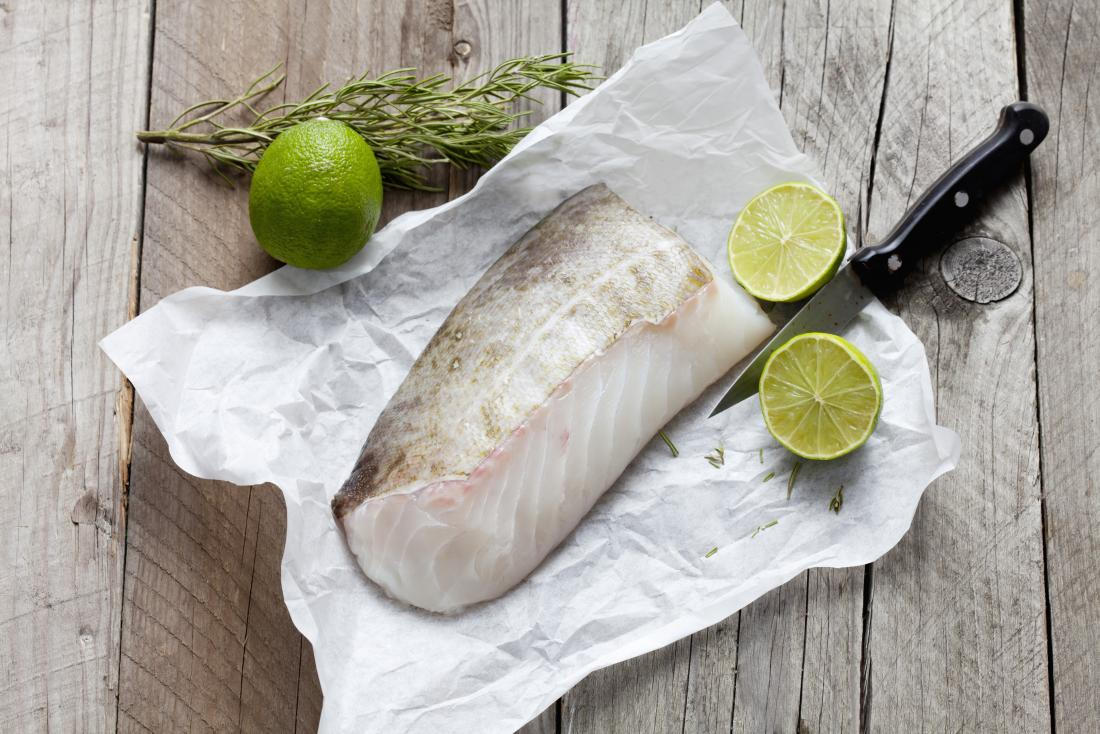 raw cod fillet on a board