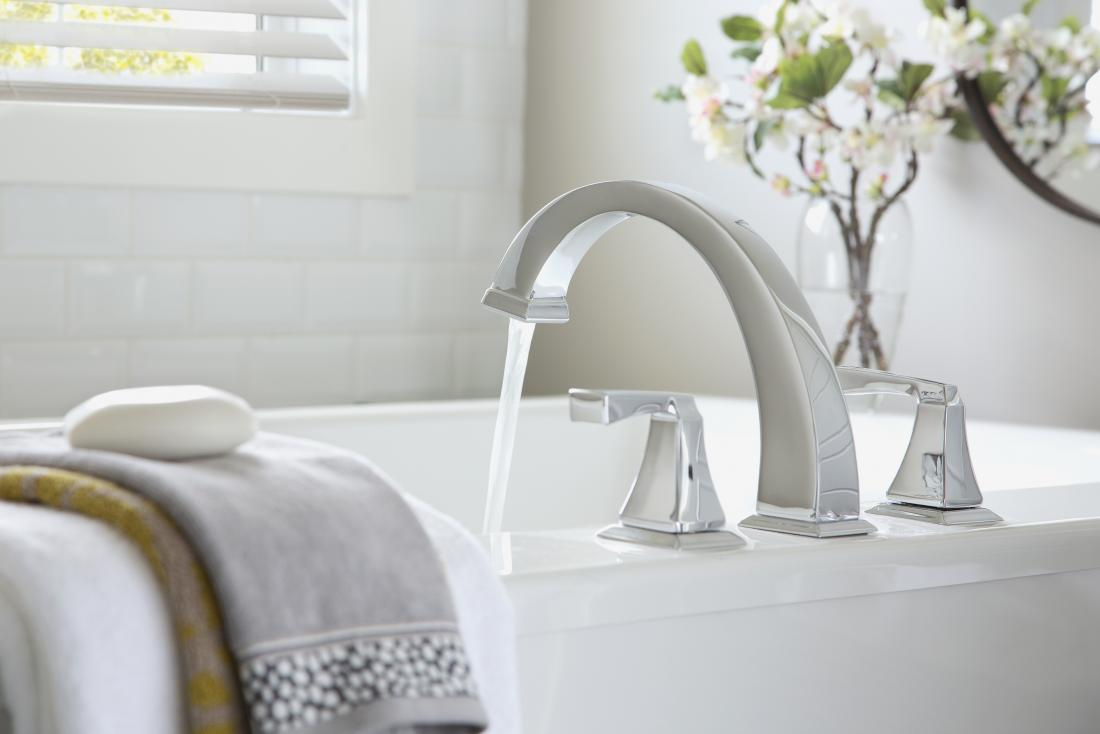 Running water from tap into bath
