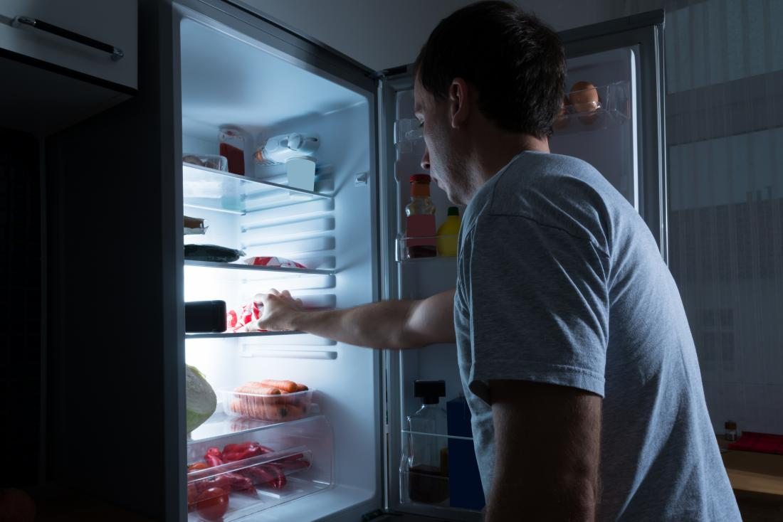 man waking up hungry and going to fridge