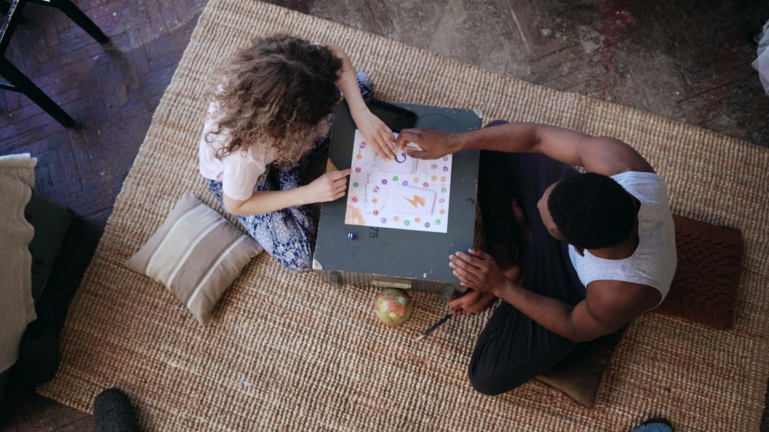 couple playing board game together