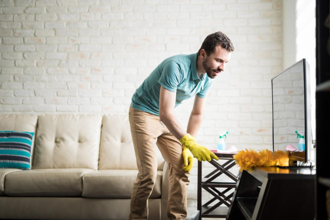 man dusting a surface exposed to endocrine disrupting chemicals