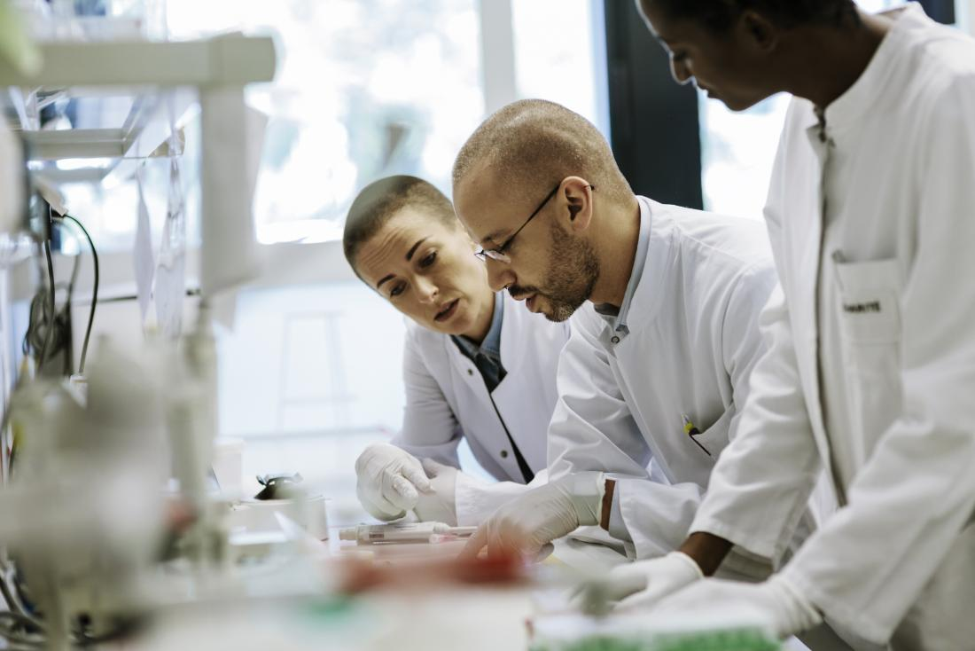 team of researchers working together in the lab