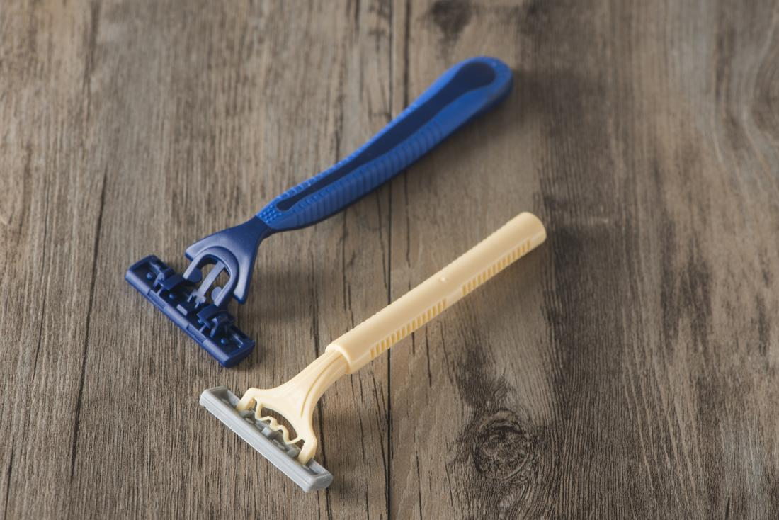 Shaving razors on wooden table