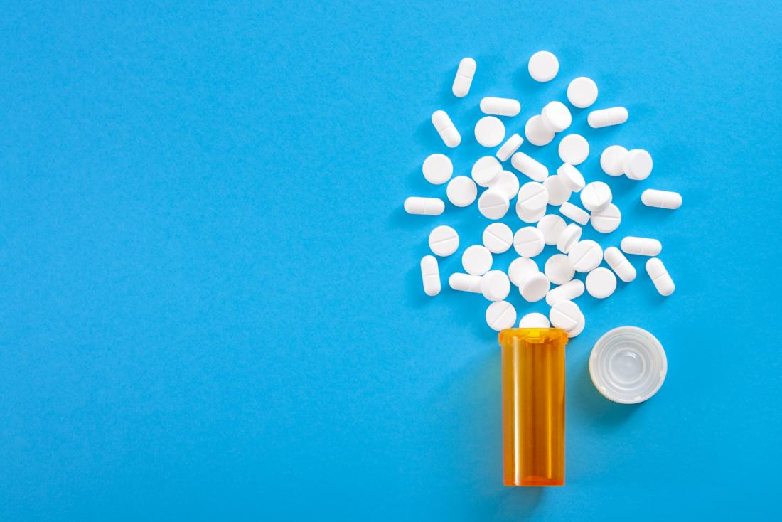 illustration of bottle of painkillers on blue background