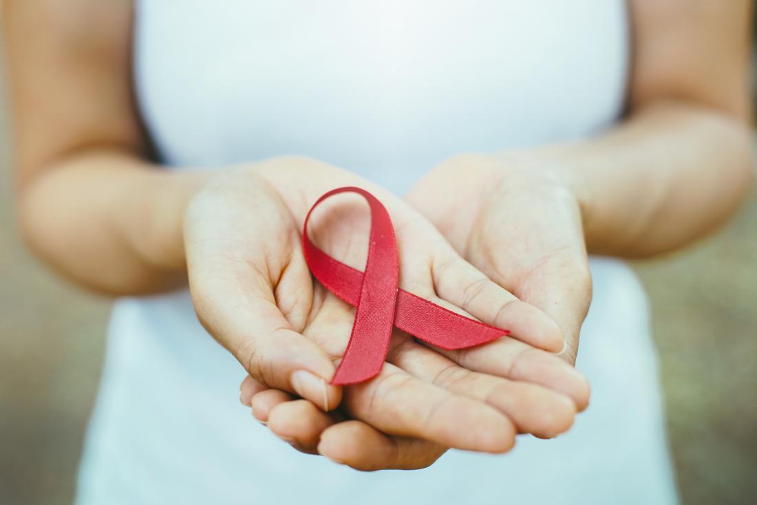 woman holding aids ribbon