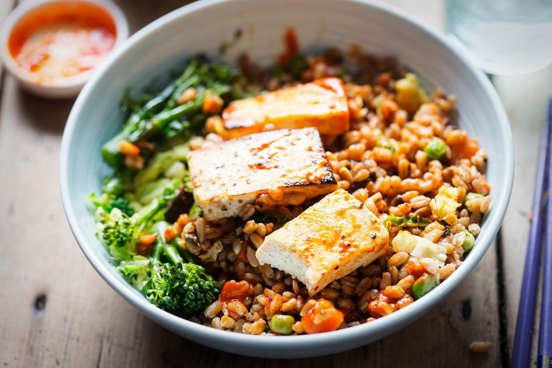 Spelt, broccoli, savoy cabbage with chargrilled tofu with sriracha as plant protein