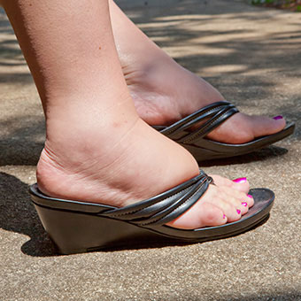 Chronic pain and skin color changes can accompany symptoms of foot swelling or ankle swelling.
