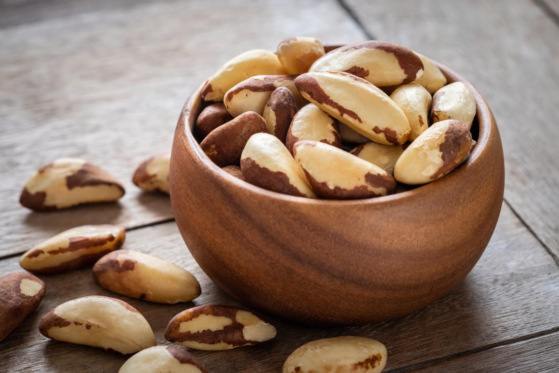 Brazil nuts as food for hair growth in bowl