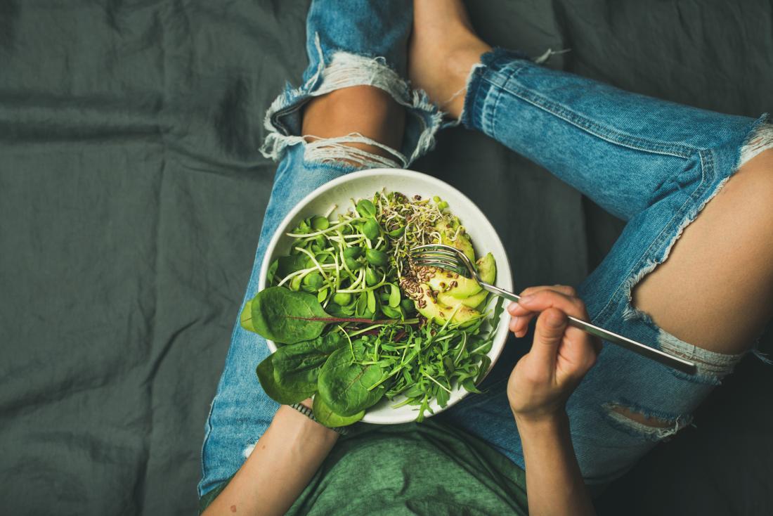 Eating avocado salad