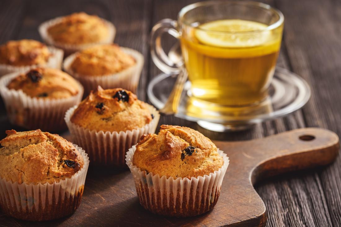 Gluten free buckwheat muffins on chopping board with herbal tea.