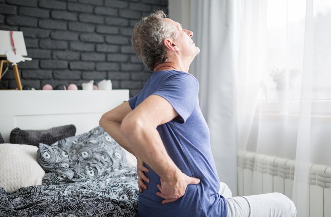 Man waking up with lower back pain