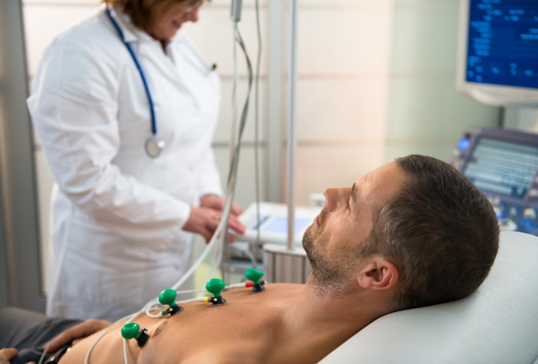 Man having an electrocardiogram or EKG in hospital