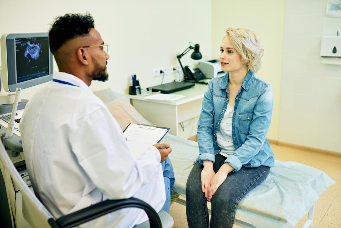 Woman in doctor or gynecologists office after ultrasound