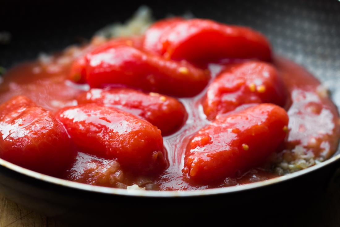 Canned peeled tomatoes in pan