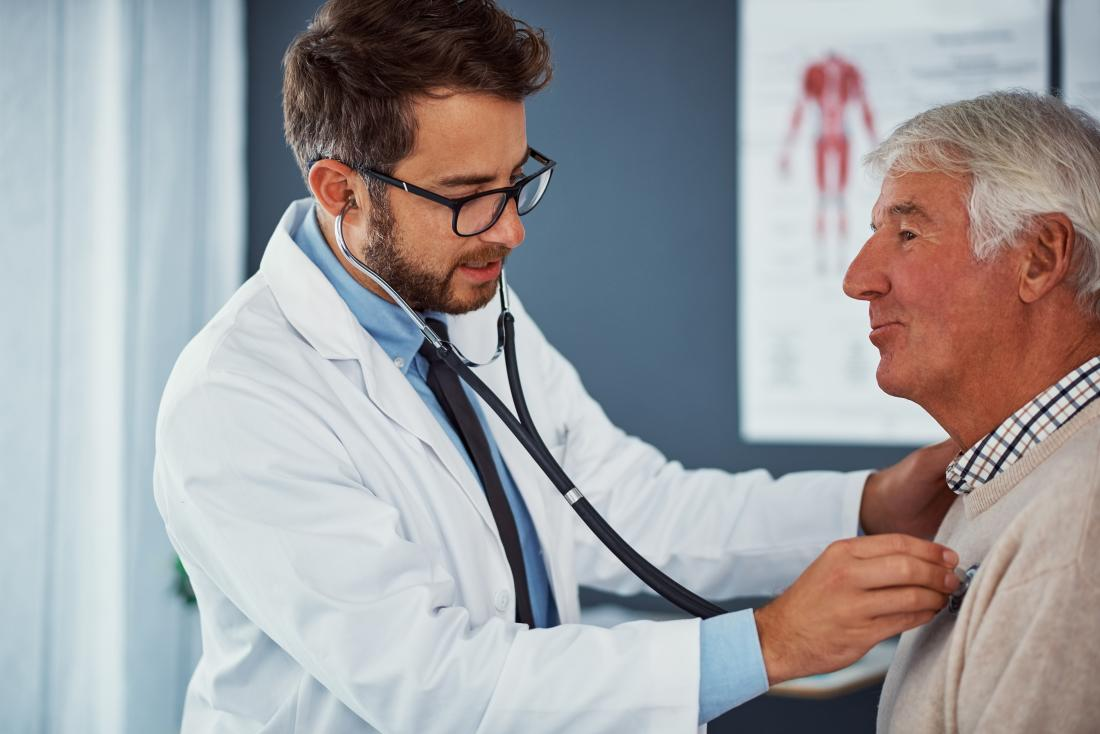 Doctor listening to patients heartbeat using stethoscope