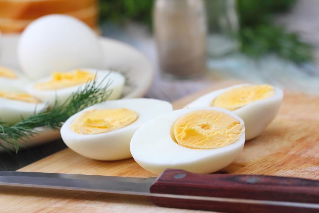 Boiled eggs on a board which are a metabolism boosting food