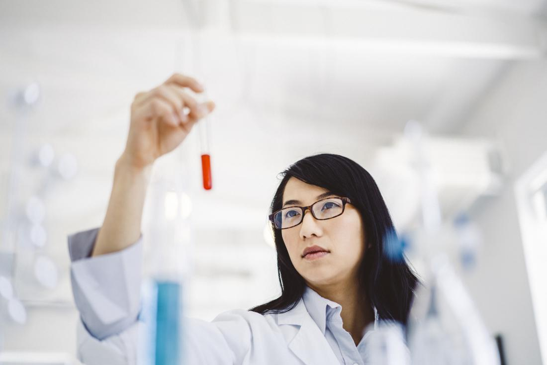 scientist looking at blood sample