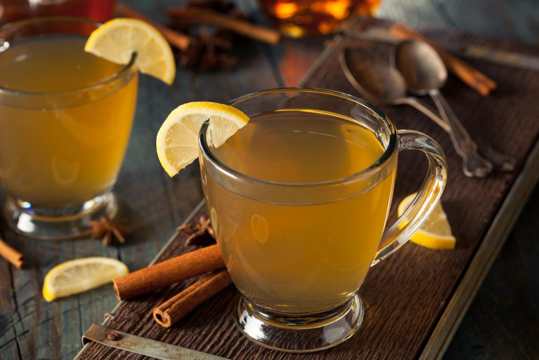 Hot toddy drink of whiskey, tea, cinnamon, lemon, sugar, and honey.