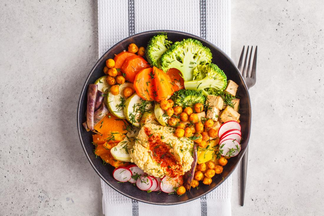 Buddha salad bowl with vegetables, tofu, chickpeas, and herbs