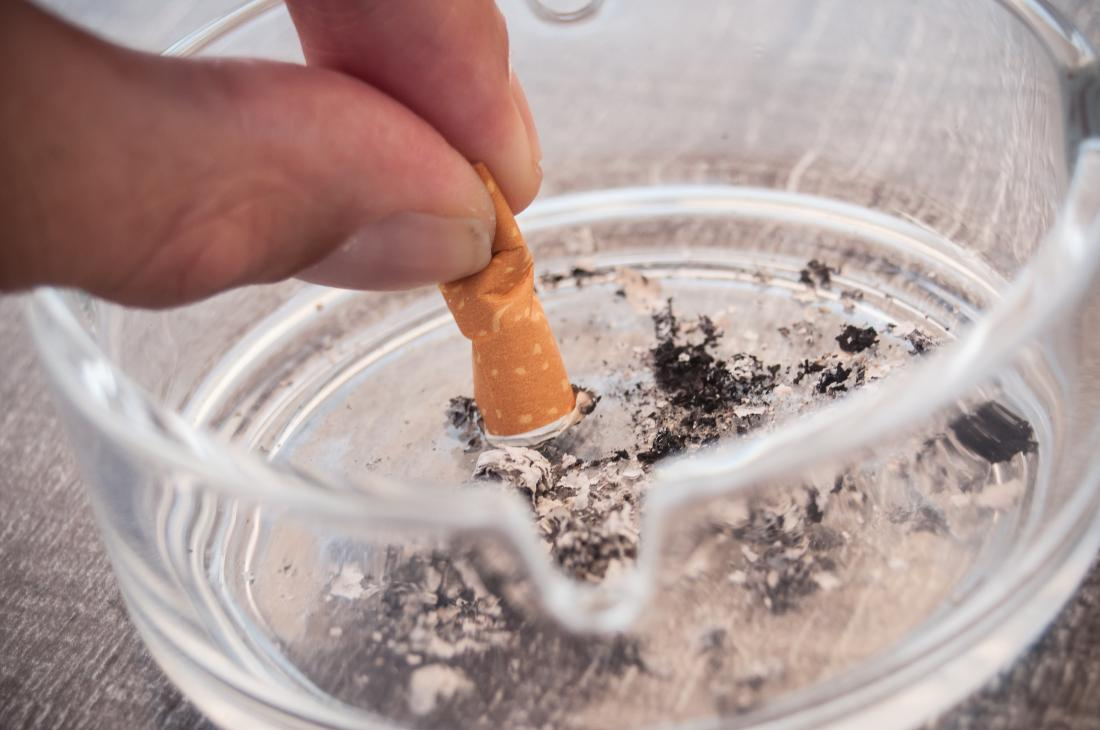 putting a cigarette out in an ashtray
