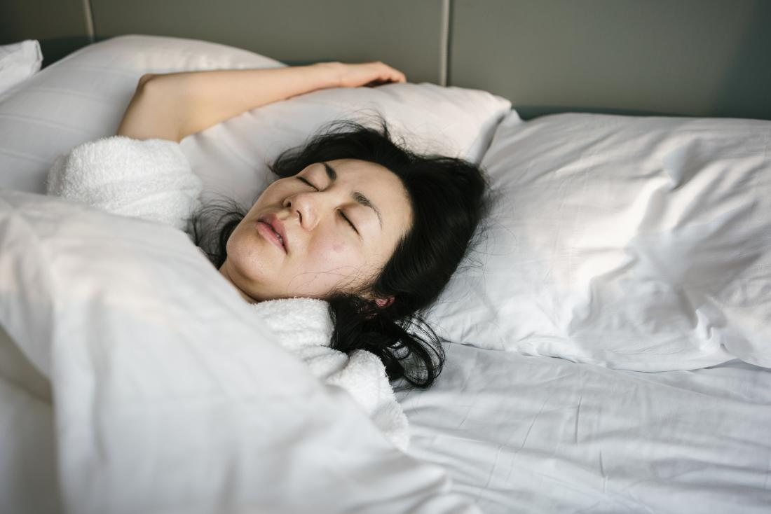 woman sleeping with parted lips