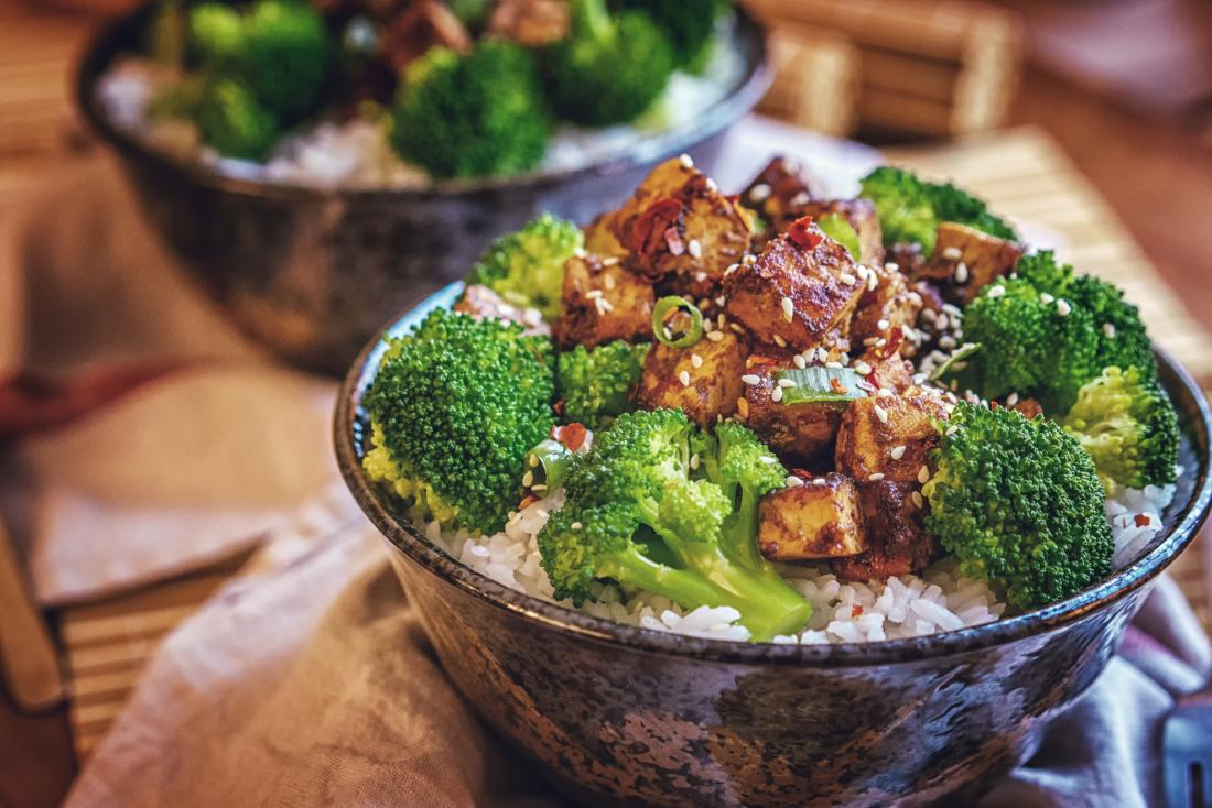 broccoli, tofu, rice and seeds in a bowl