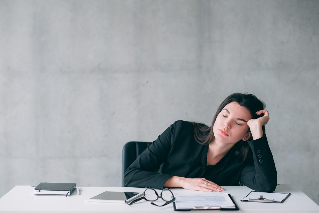 Woman falling asleep at her desk