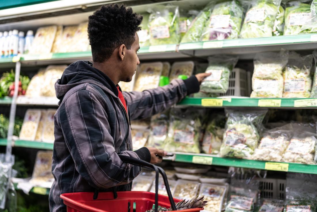 Man buying salad