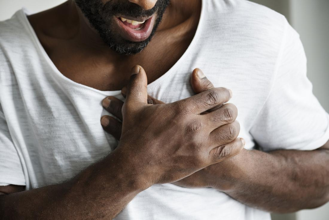 man holding chest in pain due to diaphragm spasm