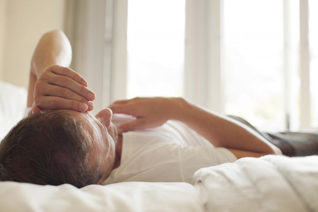 Man with morning wood lying in bed awake