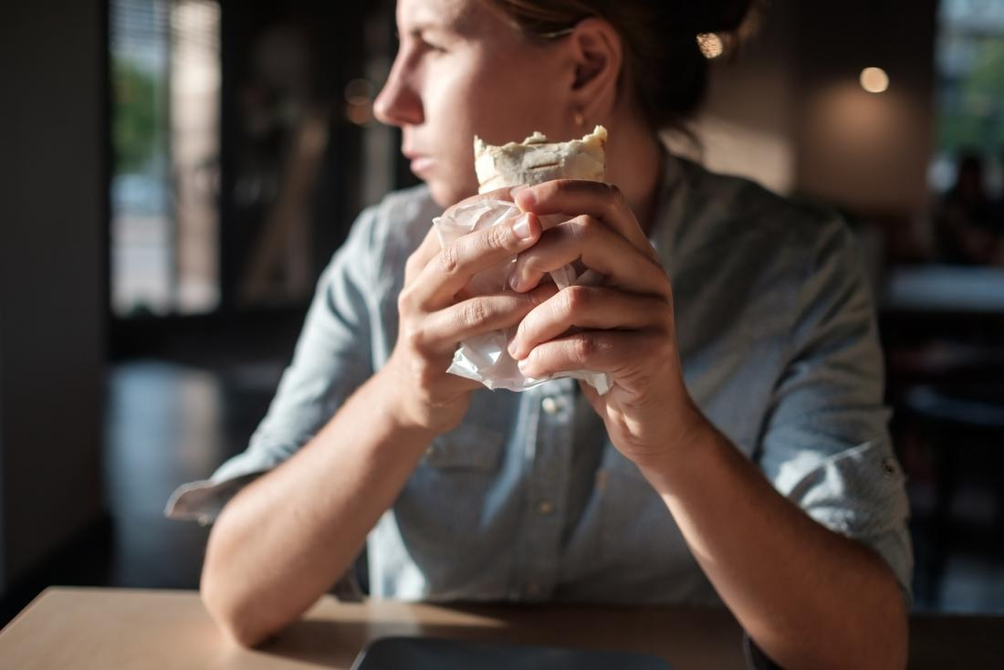 Person eating a burrito for a low-protein diet