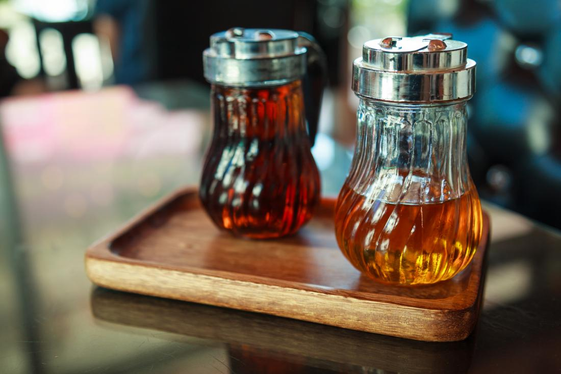 Bottles of syrup on wooden tray