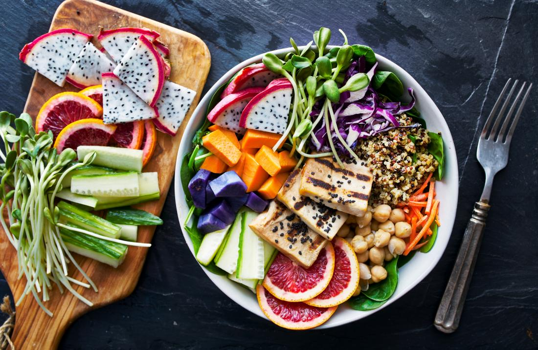 grilled tofu and dragon fruit buddha bowl with vegetables whole grain and salad