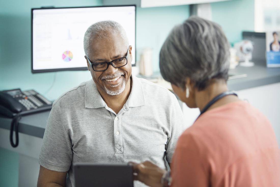 older patient speaking to doctor