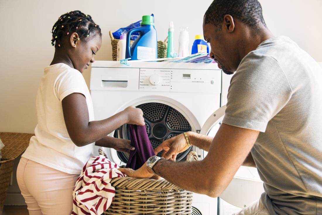 father and daughter doing the laundry