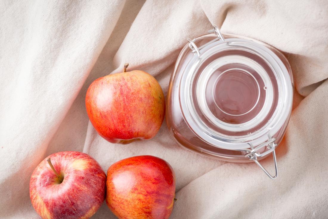 Apple cider vinegar in jar for treating gout.