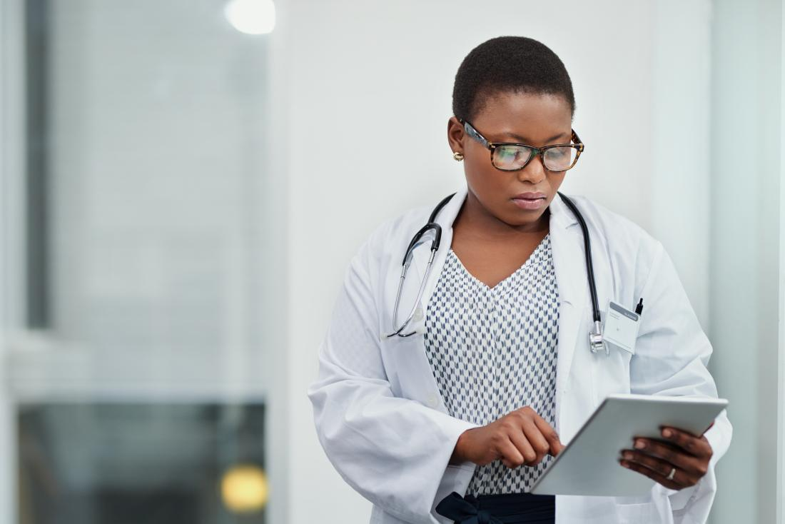 doctor checking medical record, looking concerned
