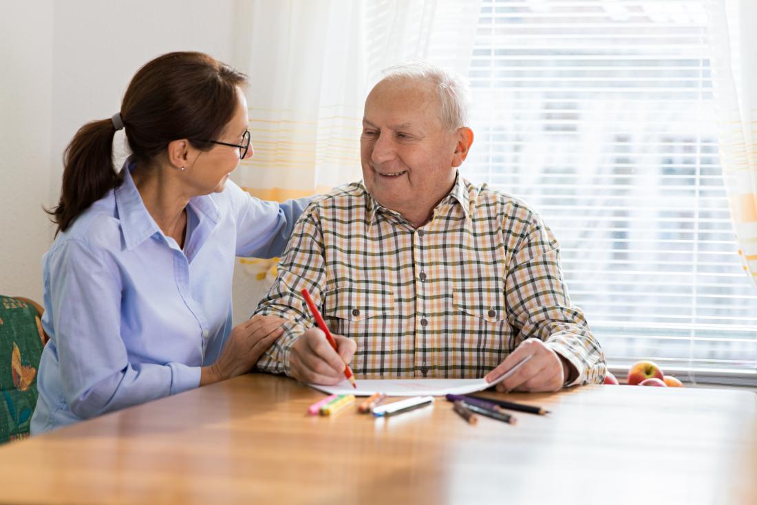 healthcare professional comforting senior man